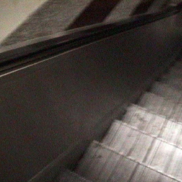 The Girl On The Escalator